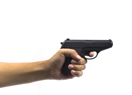 hand with gun  photo