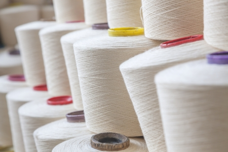 cotton threads roll in reels stacted together Stock Photo