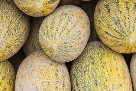 hami melon stacked in the market place Stock Photo