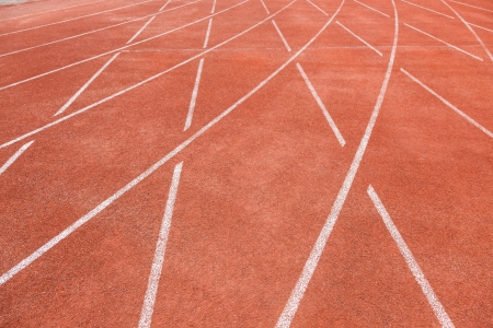 red running track field with white lines photo