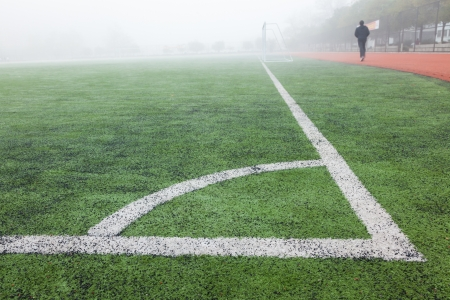 corner in the soccer field, white lines and green grass field Stock Photo - 17844332