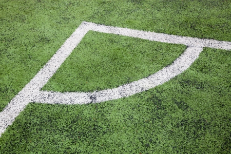 corner in the soccer field, white lines and green grass field photo