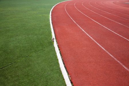 red running track field with white lines