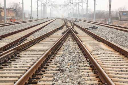 rail cross: railroad metal track with track bed