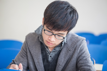 asian chinese male student studying in classroom