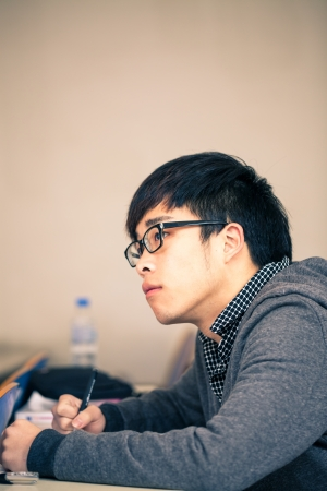 asian chinese student studying in the classroom Stock Photo