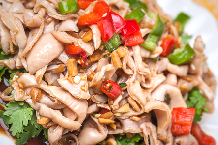 chinese pig: pig intestines stir fried with vegetables, chili peppers, a popular traditional chinese dish
