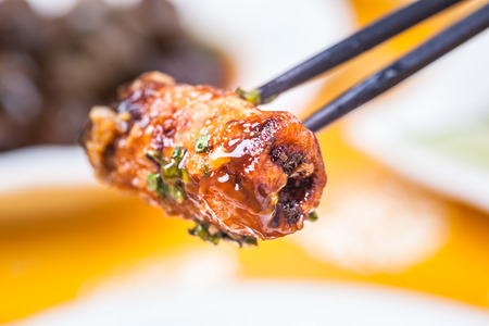 chop stick: eggplant roll fried with flour covered with  chili sauce, a popular chinese dish Stock Photo