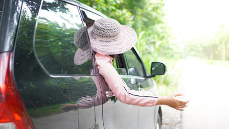 portrait of happy asian woman travelling with a car
