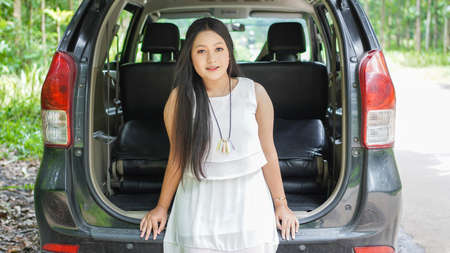 portrait of happy asian woman travelling in back car Stock Photo