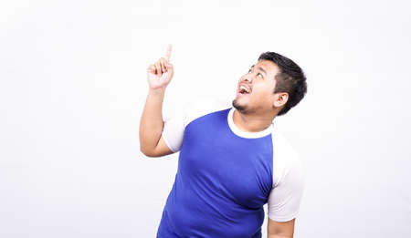 asian man pointing to blank space isolated white background
