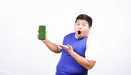 funny asian man with green screen phone isolated white background Stock fotó