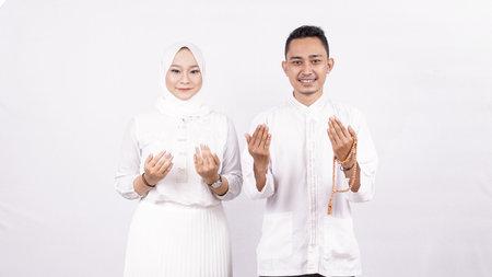 Asian molem couple pray isolated white background
