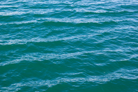 seawater: tranquil blue green wave of seawater background in the sunshine day