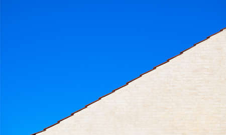 Blue sky, red roof and gable photo