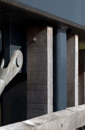 joining forces: Close up Vintage Gray Building Wooden Columns Stock Photo