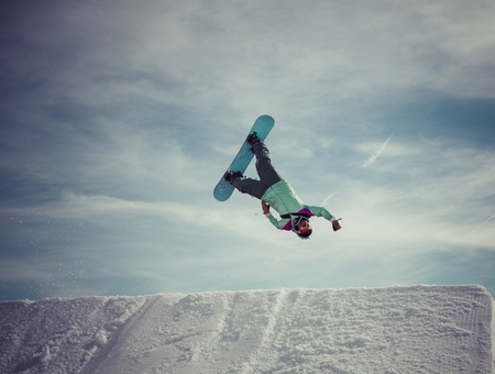 backflip: snowboarder jumping a superman backflip in Laax, Switzerland. Stock Photo