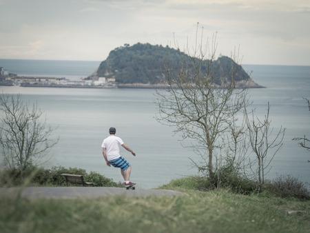 downhill: man skateboarding downhill at Zarautz, Spain