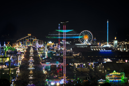 chairoplane: night shot of Oktoberfest 2015 from church Stock Photo