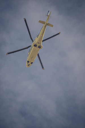 tele: low angle shot of yellow helicopter