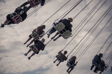 chairoplane: enjoying the chairoplane at oktoberfest 2015 oktoberfest 2015 Stock Photo