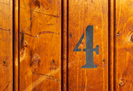 number on door of storage room for tenants in century-old apartment building in stockholm Фото со стока