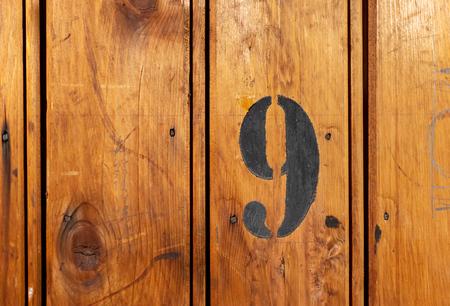 number 9 on door of storage room for tenants in century-old apartment building in stockholm