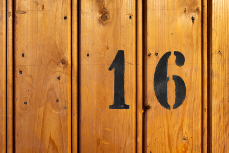 number on door of storage room for tenants in century-old apartment building in stockholm 免版税图像