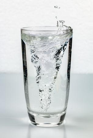 whirlpool vortex in glass of water