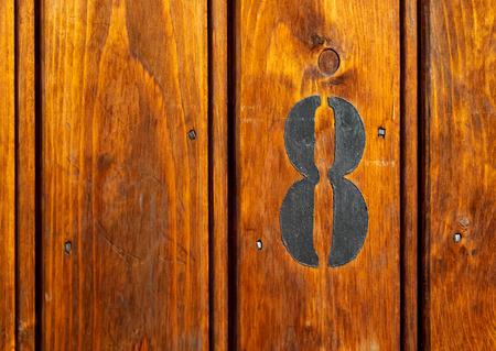 number on door of storage room for tenants in century-old apartment building in stockholm
