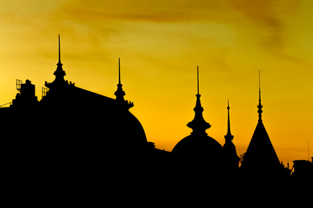 silhouette of old buildings in stockholm at dusk