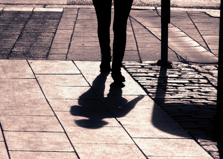 shadow of person walking in summer