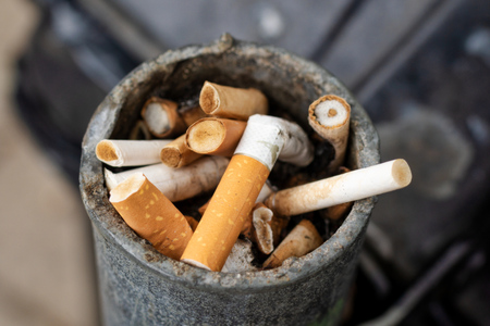 cigarette butts in outdoors ashtray