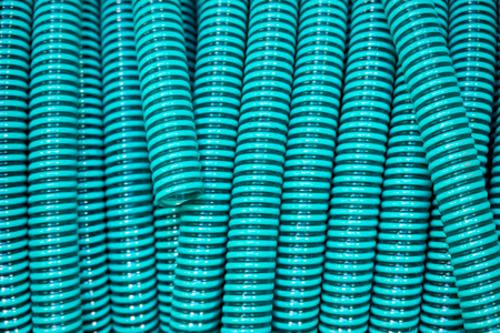 roll of turquoise colored garden hose