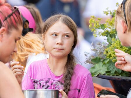 Stockholm, Sweden. 2 August, 2019. 16-year-old Swedish climate activist Greta Thunberg last demonstration in Stockholm on Fridays before going to the US. Final meal with fellow protesters Editorial
