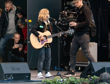 Stockholm, Sweden. 27 September, 2019. Swedish climate activists inspired by Greta Thunberg protest in Stockholm. 11-year old Oscar Stembridge performing