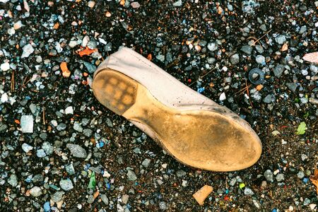 abandoned shoe in old junk yard