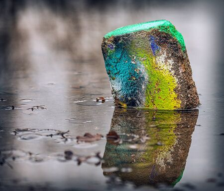 rock with paint in abandoned industry site