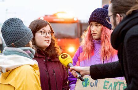 Stockholm, Sweden. 20 December, 2019. 16-year-old Swedish climate activist Greta Thunberg back in Sweden demonstrating on Mynttotget in Stockholm on Fridays. Greta and fellow protesters interviewed by Swedish news agency TT