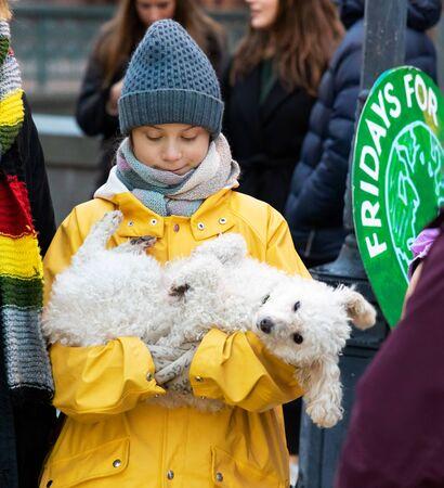 Stockholm, Sweden. 20 December, 2019. 16-year-old Swedish climate activist Greta Thunberg back in Sweden demonstrating on Mynttotget in Stockholm on Fridays. With protester poodle