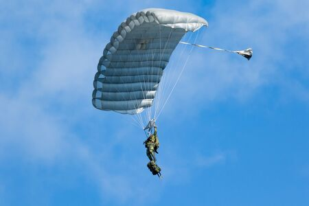 military skydiver paratrooper in summer