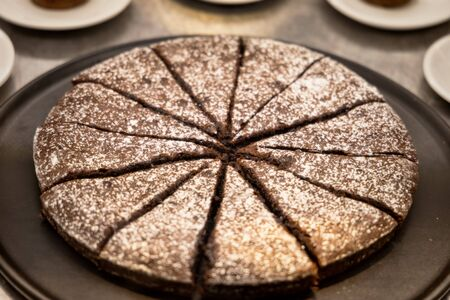 Slices of chocolate cake with powdered sugar