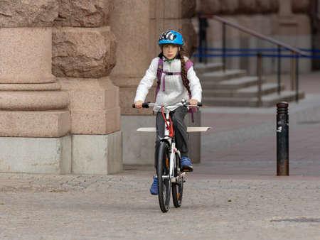 STOCKHOLM, SWEDEN - SEPTEMBER 11, 2020: 17-year-old Swedish climate activist Greta Thunberg demonstrating in Stockholm on Fridays. Arriving on bicycle.