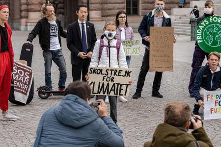 STOCKHOLM, SWEDEN - SEPTEMBER 11, 2020: 17-year-old Swedish climate activist Greta Thunberg demonstrating in Stockholm on Fridays. Holding a sign that says