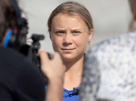 STOCKHOLM, SWEDEN - AUGUST 12, 2021: 18-year-old Swedish climate activist Greta Thunberg demonstrating in Stockholm on Fridays.