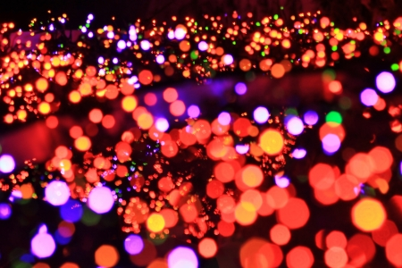 holiday season: Christmas Night Lights in Abstract Format - Beautiful Colors of the Holiday Season - Red, Blue, Yellow and Orange Dots