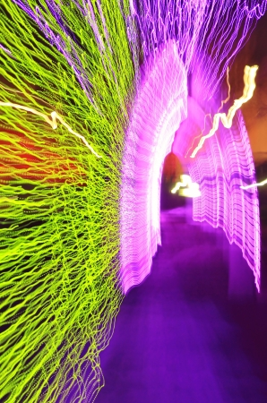 holiday season: Christmas Night Lights in Abstract Format - Beautiful Colors of the Holiday Season - Purple Portal on Blue Pathway with Green and White Sides