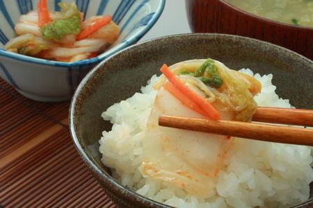 Kimchi, Korean Pickles on Rice with Chopsticks