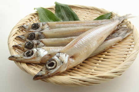 Dried Japanese silver whiting fish on white background
