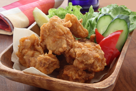 Fried Chicken with Salad in Wooden Bowl